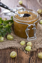 Fresh made gooseberry jam on vintage wooden background Royalty Free Stock Image