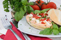 Fresh made mozzarella creme on roll tomato a at white painted wood Royalty Free Stock Images