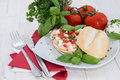 Fresh made mozzarella creme on roll tomato a at white painted wood Royalty Free Stock Photography