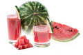 Fresh made watermelon juice fresh fruit pieces isolated white Stock Photo