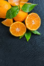 Fresh mandarin on black stone dewy placed top view copyspace for text Stock Photography