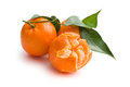 Fresh mandarin with green leaves on white background Stock Images