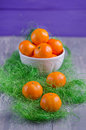 Fresh mandarins bowl of on wooden board Stock Photo
