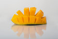 Fresh mango a half and ripe cube cut Stock Photography