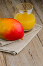 Fresh mango juice and fruit Royalty Free Stock Photo