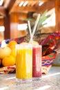 Fresh mango and strawberry juices Royalty Free Stock Photo