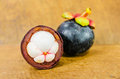 Fresh mangosteen on wooden background garcinia mangostana linn Stock Photo