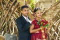 Fresh married couple colombo sri lanka aug happy poses for tourists and photographers at a big wedding ceremony on july in colombo Royalty Free Stock Images