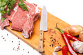 Fresh meat of beef with bone on wooden spices and knife Royalty Free Stock Photo