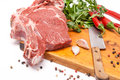 Fresh meat of beef with bone on wooden spices and knife Royalty Free Stock Photos