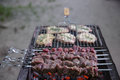 Fresh meat on grill outdoors
