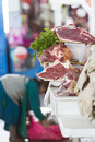 Fresh meat and Peruvian woman working at cusco market, Peru Royalty Free Stock Photo