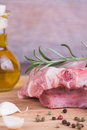 Fresh meat with rosemary on wooden background Stock Photo