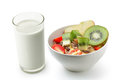 Fresh milk in the glass and muesli breakfast placed on white bac Royalty Free Stock Photo