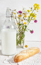 Fresh milk in old fashioned bottle with baguette Royalty Free Stock Photo