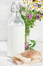 Fresh milk in old fashioned bottle and homemade bread Royalty Free Stock Photo