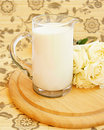 Fresh milk and roses Stock Image