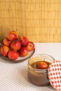 Fresh mini apples with jar of caramel Royalty Free Stock Photo