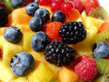 Fresh mixed fruit and berries  Stock Photos