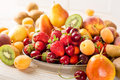 Fresh mixed fruits, berries on plate. Summer fruit, berry. Royalty Free Stock Photo