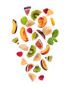 Fresh mixed fruits pieces falling, fruit salad Royalty Free Stock Photo