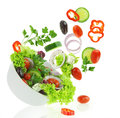 Fresh mixed vegetables falling bowl salad Royalty Free Stock Photography