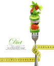 Fresh mixed vegetables fork measuring tape Stock Image