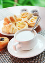 Fresh muffins and tea with milk, breakfast Stock Images