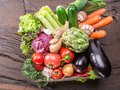 Fresh multi-colored vegetables in wooden crate. Top view. Royalty Free Stock Photo