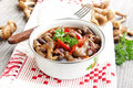 Fresh mushroom stew with red pepper and parsley Royalty Free Stock Photo