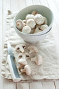 Fresh mushrooms in white plate on linen fabric and wooden background and cut in slices Royalty Free Stock Images
