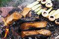 Fresh mushrooms and zucchini grilling on an outdoor barbecue Royalty Free Stock Photo