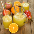 Fresh natural fruit juice on brown background Stock Photography
