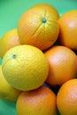Fresh navel orange fruits on green background Stock Photography