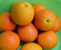 Fresh navel orange fruits on green background Stock Photos