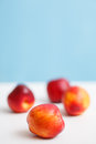 Fresh nectarines on the table Stock Photos