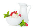 Fresh oat flakes with berries and milk jug Royalty Free Stock Photo