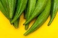 Fresh okra ladyfingers on yellow background Royalty Free Stock Images