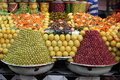 Fresh olives and bottled food market stall selling in marrakech morocco Royalty Free Stock Photos