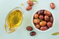 Fresh olives in white bowl on wooden table rustic Royalty Free Stock Image
