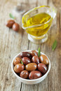 Fresh olives in white bowl on wooden table rustic Royalty Free Stock Photo