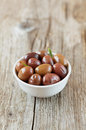 Fresh olives in white bowl on wooden table rustic Royalty Free Stock Photography