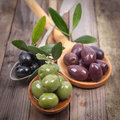 Fresh olives on wooden ground Stock Photography