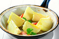 Fresh onion quarters in a pan frying Royalty Free Stock Image