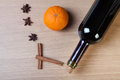 Fresh orange, bottle of vine and spices on a light wooden table Royalty Free Stock Photo