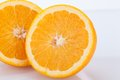Fresh orange halved to show the pulp Royalty Free Stock Photo