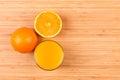Fresh orange juice glass with sliced fruits flat lay Royalty Free Stock Image