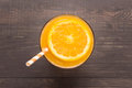 Fresh orange juice in glass on wooden background Royalty Free Stock Photo