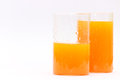 Fresh orange juice glasses of and water droplets one is half empty and other is full Stock Photo