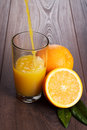 Fresh orange juice pouring into glass on the table Royalty Free Stock Photo